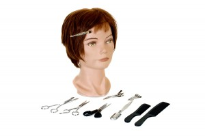 Mannequin head with scissors, combs and clips