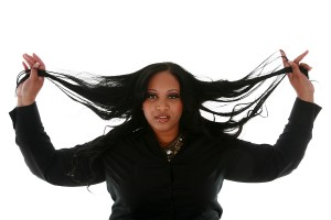 Woman holding her hair extensions